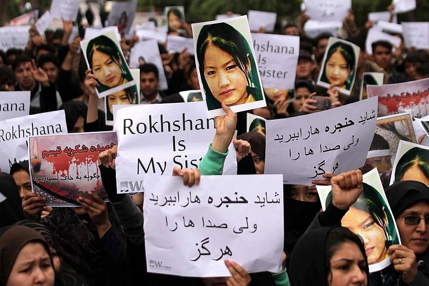 Protesters, with photos of one of the victims, shouting slogans against the Taleban and ISIS on Thursday. The three million-strong Afghan Hazara community has been persecuted for decades, with thousands killed in the 1990s by Al-Qaeda and the Pashtun