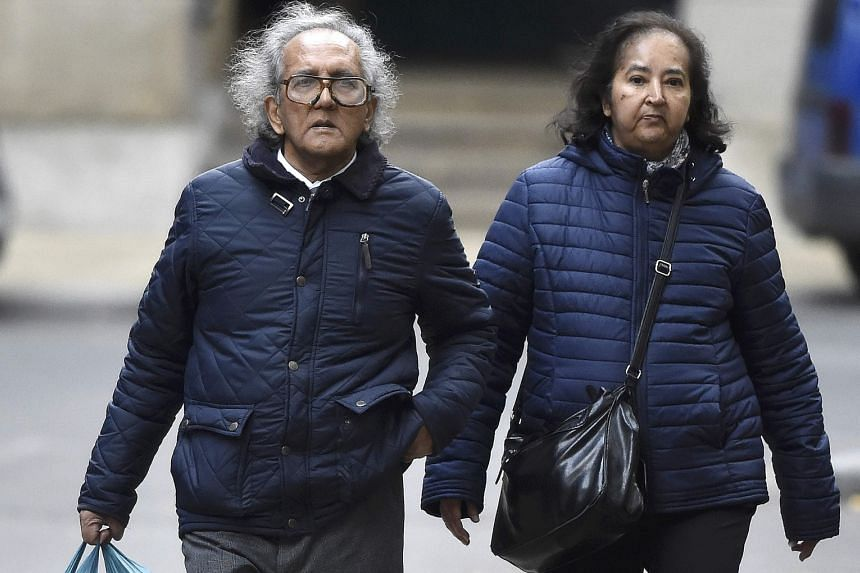 Aravindan Balakrishnan arriving at London's Southwark Crown Court on Wednesday with an unidentified woman. He faces charges relating to three women, including his daughter, whom he allegedly abused in his Maoist commune.