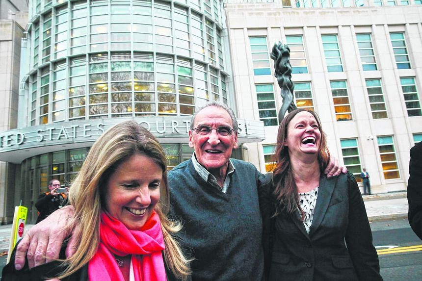 """Mr Vincent Asaro, 80, seen here with his lawyers, raised his hands in the air and shouted """"Free!"""" outside the court in Brooklyn after a jury found him not guilty on Thursday."""