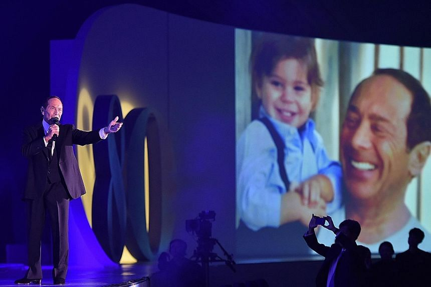 Legendary pop and jazz star Paul Anka performing at United Overseas Bank's 80th anniversary dinner on Thursday night. The singer re-crafted the lyrics to the song My Way specially for the bank and Singapore during his performance.