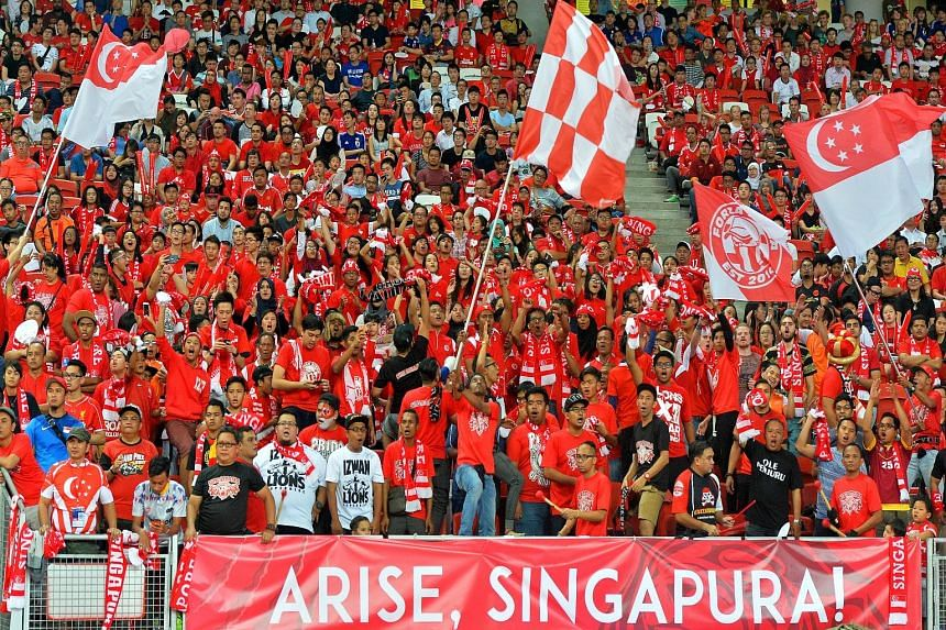 Singapore fans mostly all decked in red, showing their support for the Lions during the Singapore-Japan Group E World Cup qualifier on Thursday.