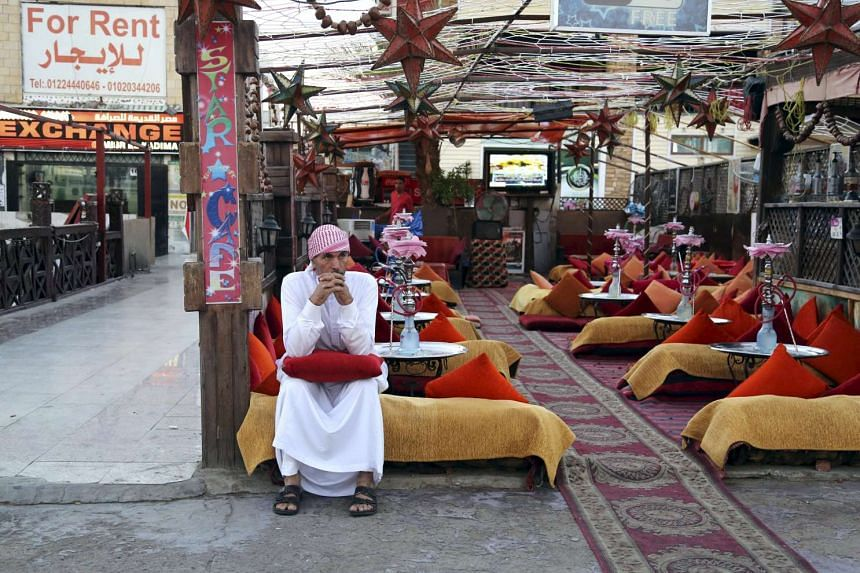A cafe employee sits waiting for customers at the Red Sea resort of Sharm el-Sheikh.