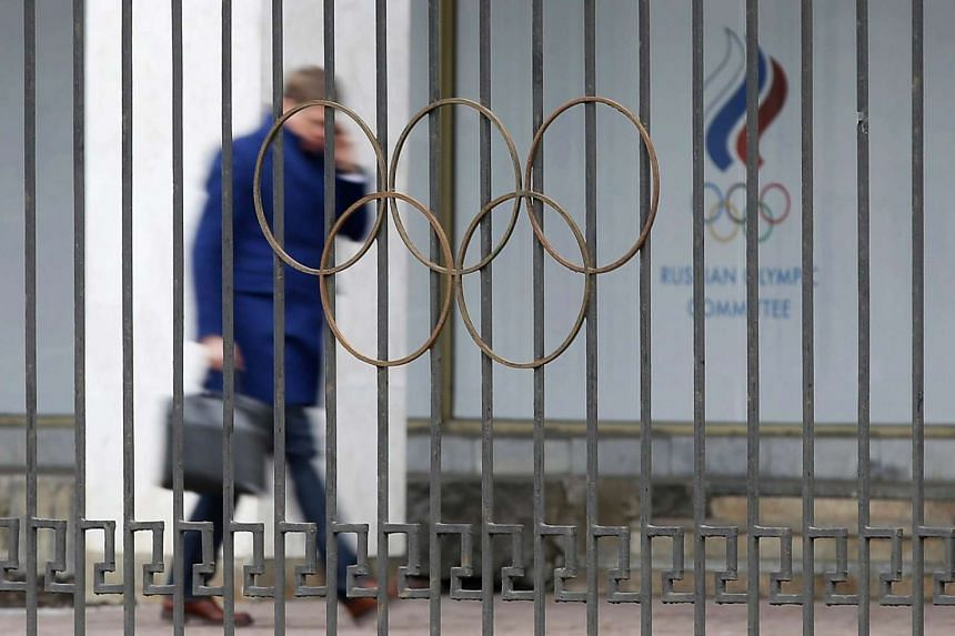 A man walking outside the Russian Olympic Committee headquarters and Russian Athletics Federation office in Moscow.