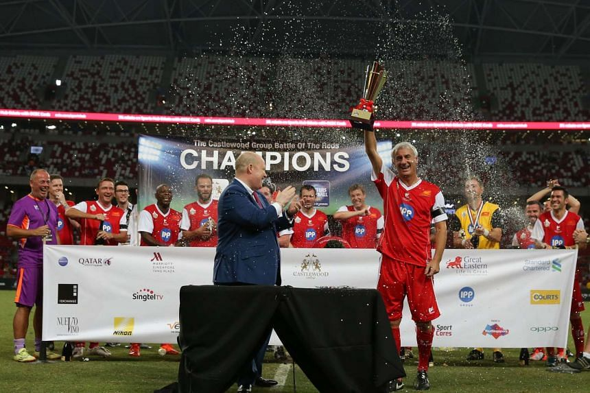 Former Liverpool forward Ian Rush raising the trophy after the Liverpool Masters defeated the Manchester United Masters 2-0 at the Singapore National Stadium on Nov 14, 2015.