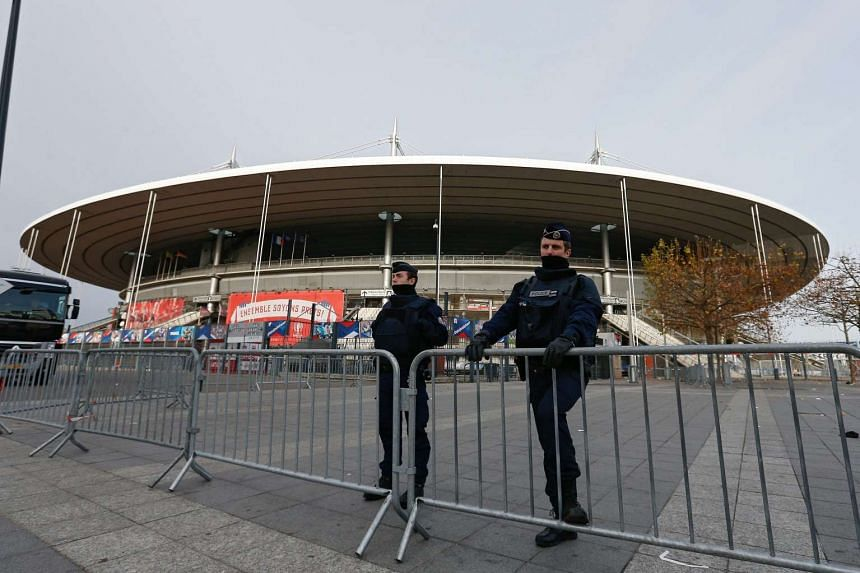 French police officers standing guard in front of the Stade de France stadium in Paris, on Nov 14, 2015.