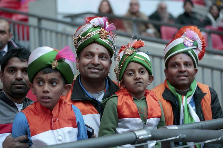 People watch the event at Wembley Stadium attended by India's Prime Minister Narendra Modi.
