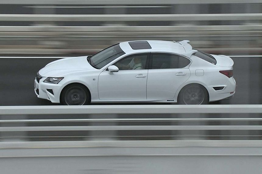 The Lexus GS450h hybrid saloon has a spoiler above its rear windscreen which houses sensors and radars.