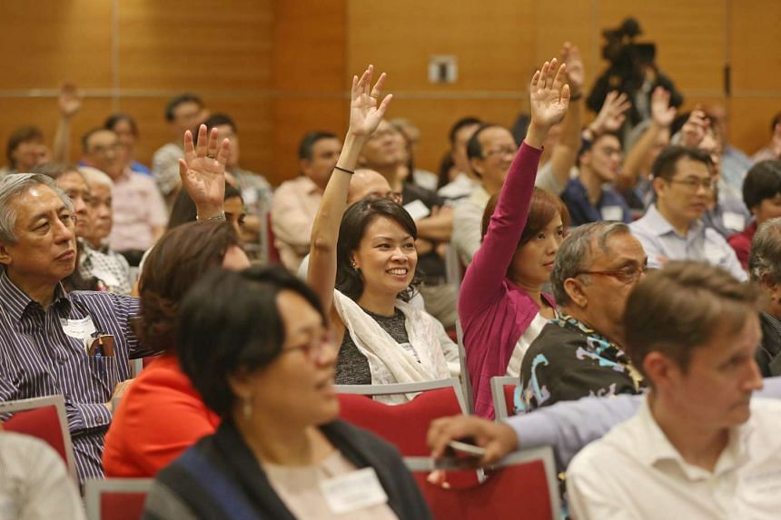 Members of the audience seeking to pose their questions during the dialogue at the SPH News Centre auditorium yesterday.