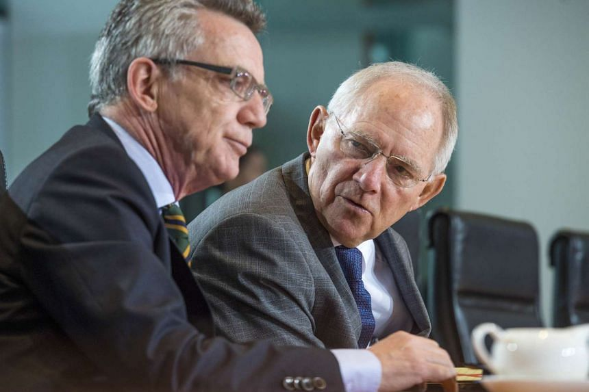 After Interior Minister Thomas de Maiziere (left) said that Syrians granted refugee status could not bring their relatives into Germany, Finance Minister Wolfgang Schaeuble came out to back him publicly.