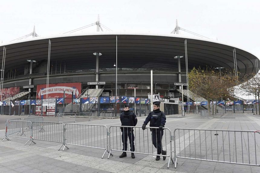 Police secure the area outside the Stade de France stadium, on the outskirts of Paris.