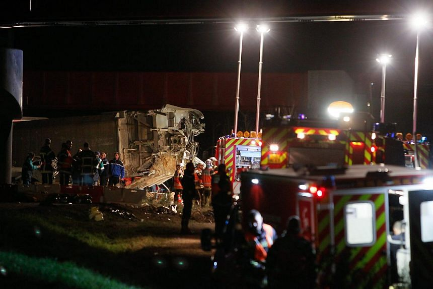 Emergency workers at the scene of a crash of a TGV train that fell from a bridge in Eckwersheim, France, on Nov 14, 2015.