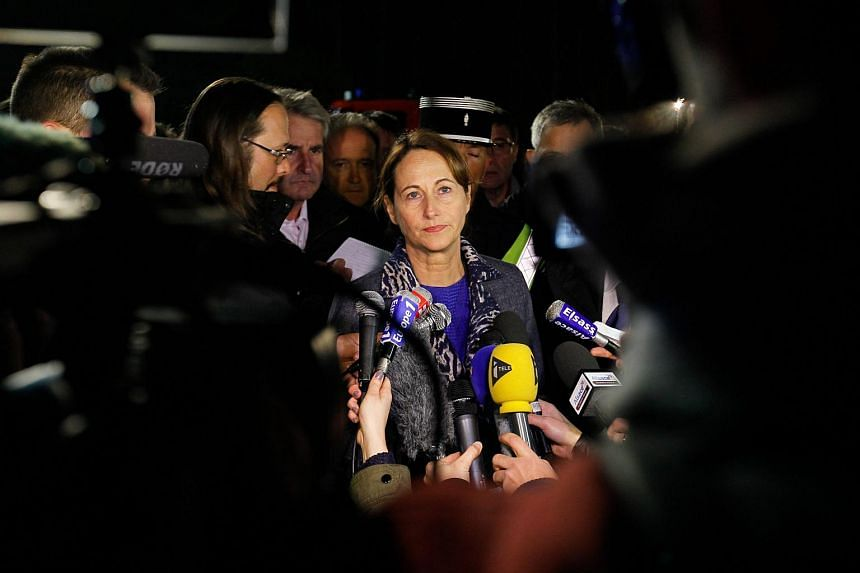 French Minister for Ecology, Sustainable Development and Energy, Segolene Royale (centre), gives a press conference outside the scene of a crash of the TGV train.
