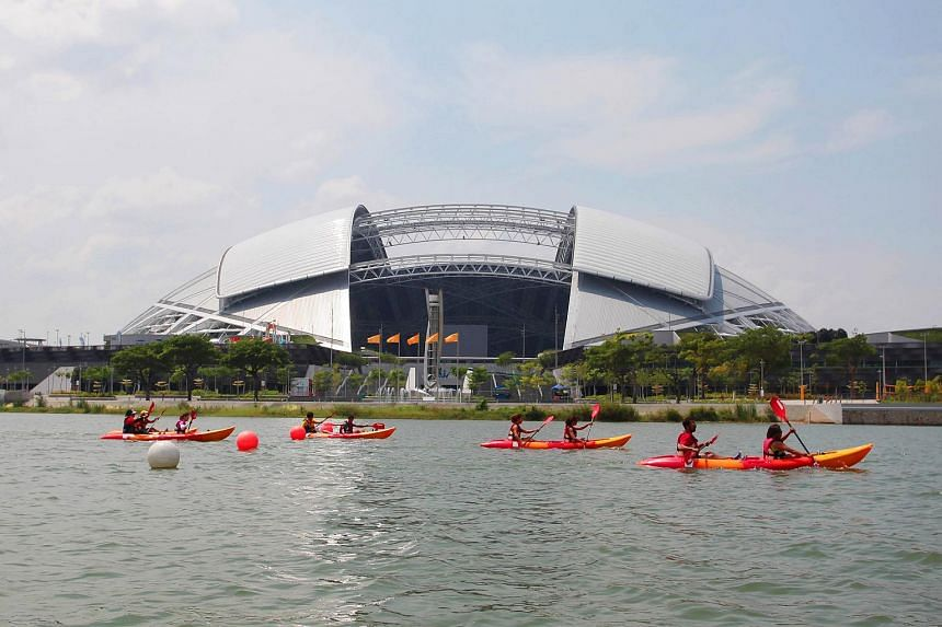 Water sports enthusiasts canoeing at the Water Sports Centre at the Singapore Sports Hub.