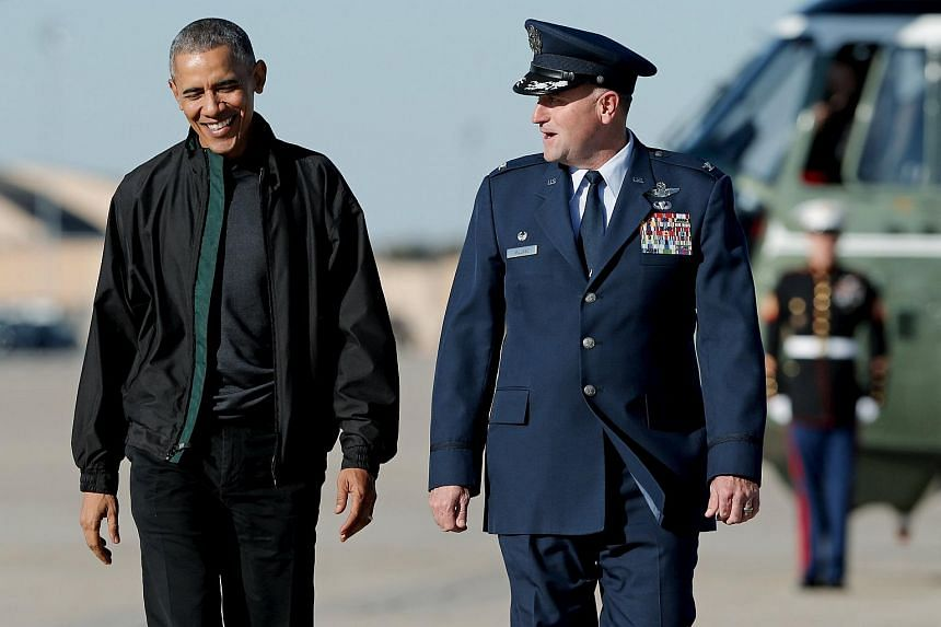 Barack Obama (left) walks with US Air Force Colonel John Millard as he arrives to board Air Force One to travel to the G20 summit in Turkey.