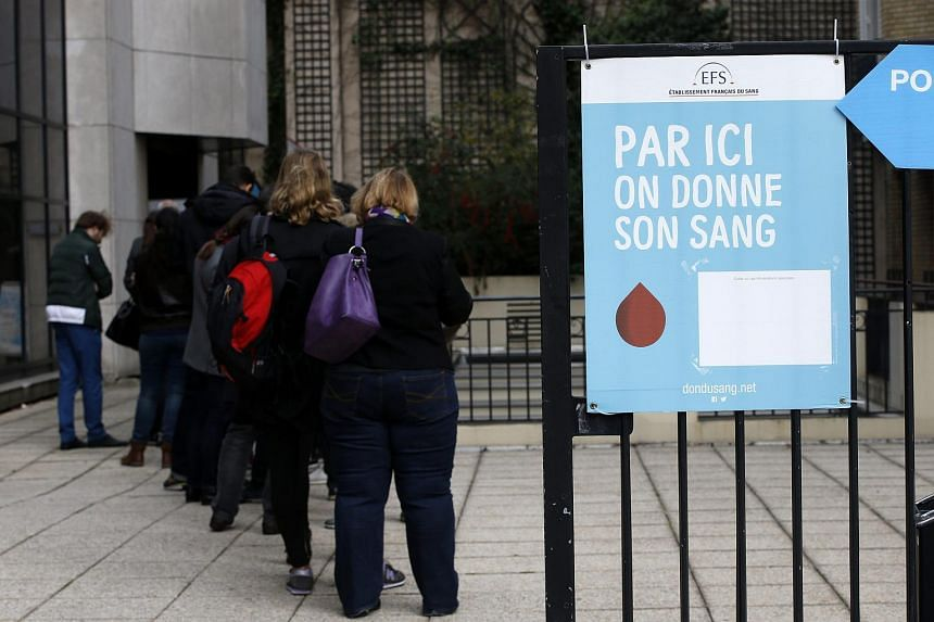 People queue ouside the 'Etablissement Francais du Sang' (French National Blood Service) to make a blood donation after the Paris attacks, in Paris, France, on Nov 14 2015.