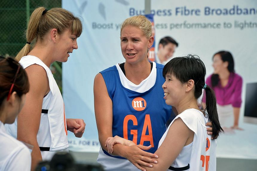 New Zealand netball legend Irene va Dyk (left) having a chat with Ms Jessica Tan (right), president of Netball Singapore, and Silver Ferns captain Casey Kopua (centre) at the M1 Corporate Challenge.