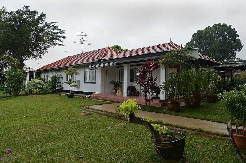 The black-andwhite bungalows (above) used to house British Royal Air Force servicemen and their families. (Left) One of several barracks in Seletar.