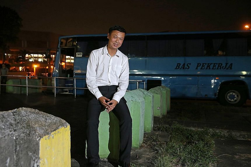 Bus spotter Bernard Wee at his favourite spot, a former bus interchange in Woodlands Centre Road. The berths are now occupied by private buses and heavy vehicles.