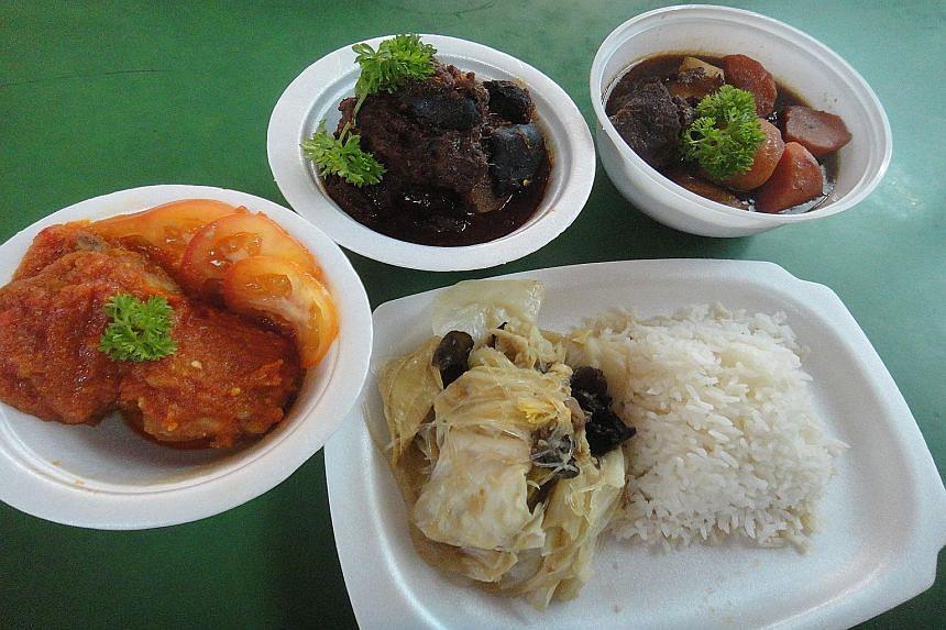 From left: Popo & Nana's Nonya Ayam Masak Merak, Nonya Pork Rib Buah Keluak and Beef Smore served with rice and chap chye.