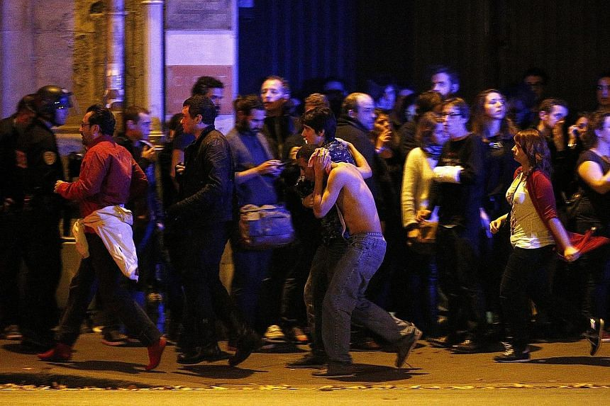 Wounded people being taken out of the Bataclan theatre in Paris following the shootings and hostage situation that took place on Friday night. French President Francois Hollande said yesterday that the attacks in the city, which killed at least 128 p
