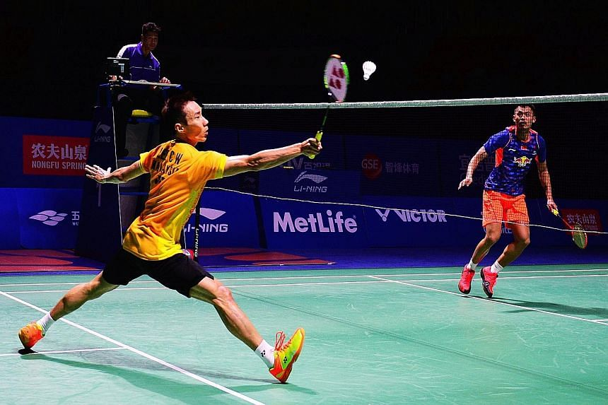 Lee Chong Wei (left) and Lin Dan in action during the China Open semi-finals. Lee beat Lin to set up a showdown with Chen Long in the final.