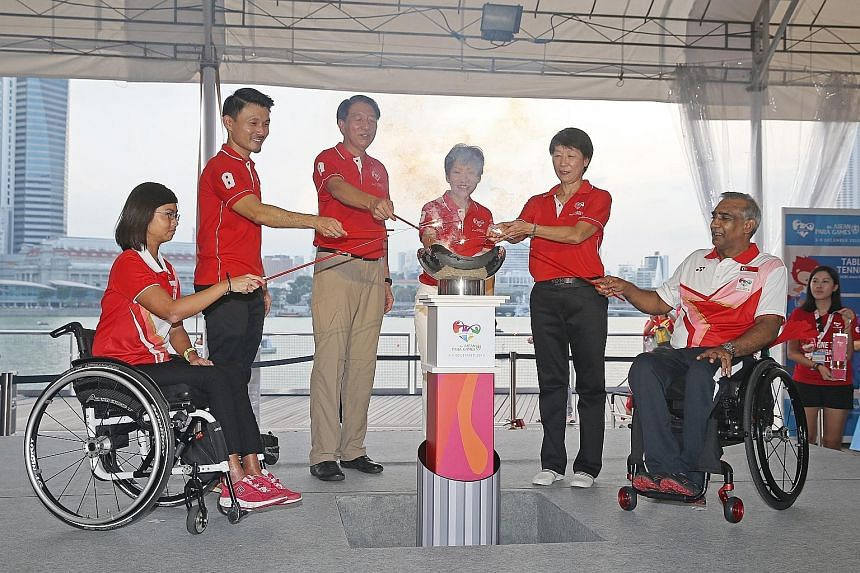 Above, from left: Para sailor Yap Qian Yin, Parliamentary Secretary Baey Yam Keng, Deputy Prime Minister Teo Chee Hean, Minister for Culture, Community and Youth Grace Fu, Dr Teo-Koh Sock Miang (chairman, Singapore National Paralympic Council) and Ra
