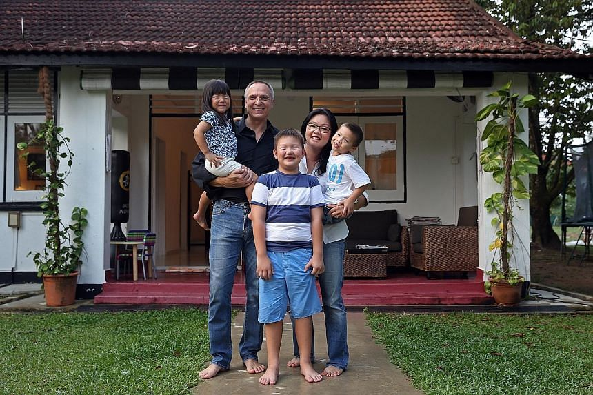 Madam Veronica Low and her husband, Mr Stephen Vass, with their adopted daughter Madeline, and sons Gregory, eight, and Christopher, five. When the call to adopt the Chinese girl came after a seven-year wait, the couple decided to go ahead with the a