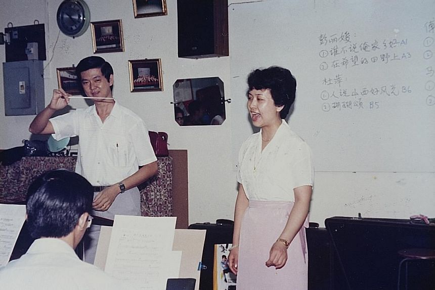 An old photo of Mr Ang Lam Seng, then Zhong Yi Traditional Orchestra's conductor, with a young Ms Peng Liyuan, taken during her visit to Singapore in 1987. Members of the orchestra who met Ms Peng Liyuan included (from left) Mr Ang Lam Seng, Mr Lim B