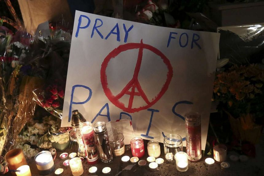"A ""Pray for Paris"" sign is pictured at a makeshift memorial outside the consulate of France to commemorate the attacks in Paris, in the Manhattan borough of New York Nov 14, 2015."