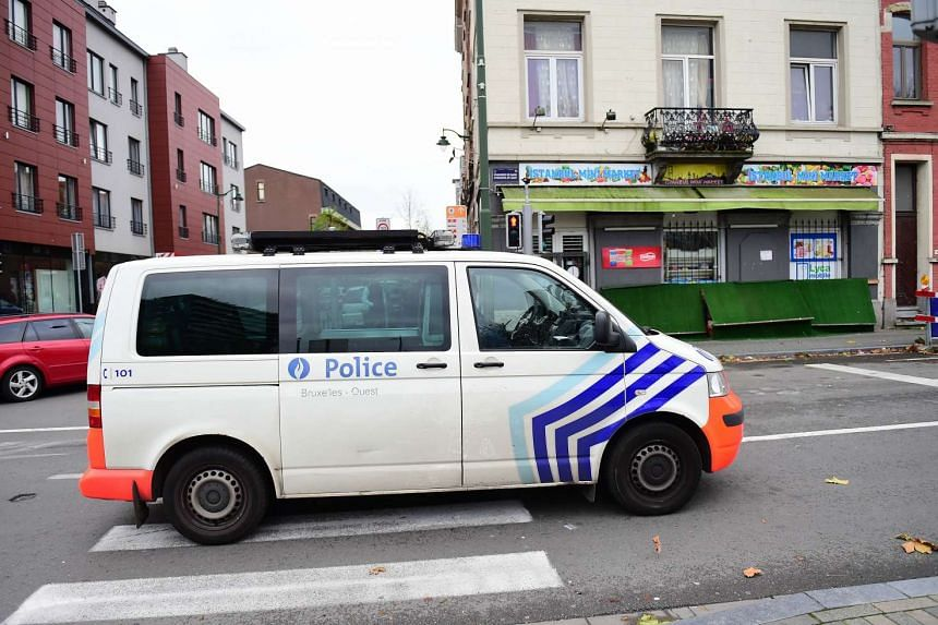 A police van makes its way in the vicinity of a police intervention in Brussels to arrest people in connection with the deadly attacks in Paris.