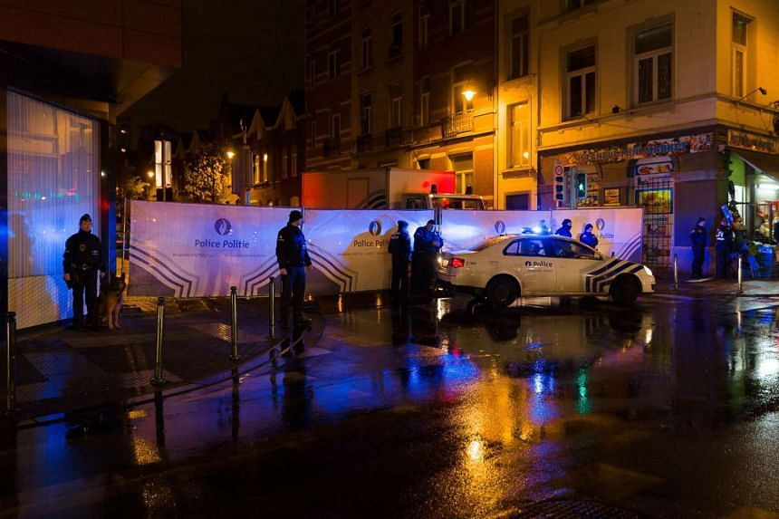 Belgian police cordon off a street during a police raid in Brussels' Molenbeek district on Nov 14, 2015.