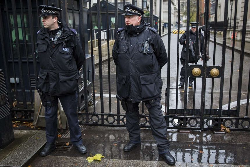 Armed police officers standing guard outside Downing Street in central London on Nov 14, 2015.