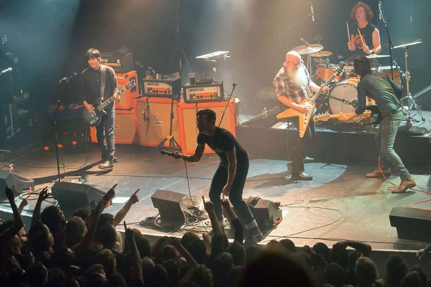 American rock group Eagles of Death Metal perform on stage at the Bataclan concert hall.