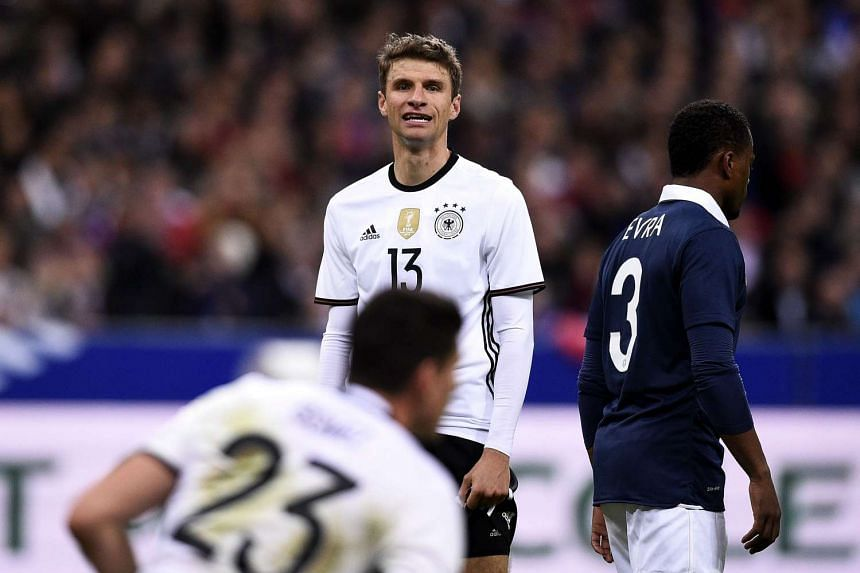 Germany's midfielder Thomas Muller reacts during a friendly international football match between France and Germany.