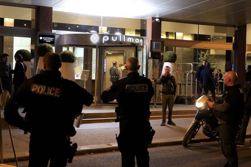 French police gather outside the Pullman Hotel as authorities continue to search for accomplices to Friday night's fatal series of shootings.