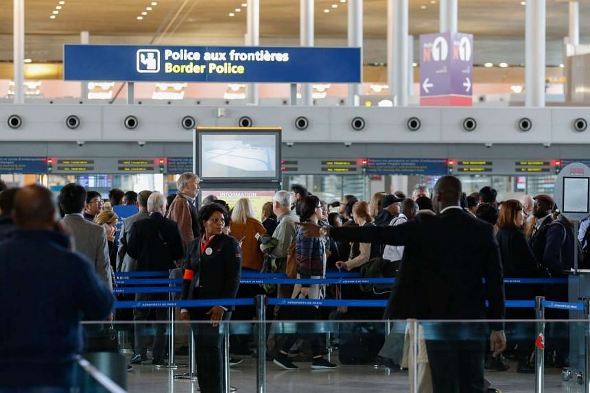 People queueing at the Charles De Gaulle Airport in Paris, France, on Nov 14 2015.