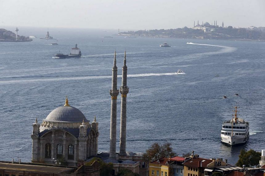 A passenger ferry arrives at Ortakoy pier in the European side of Istanbul on Sunday.