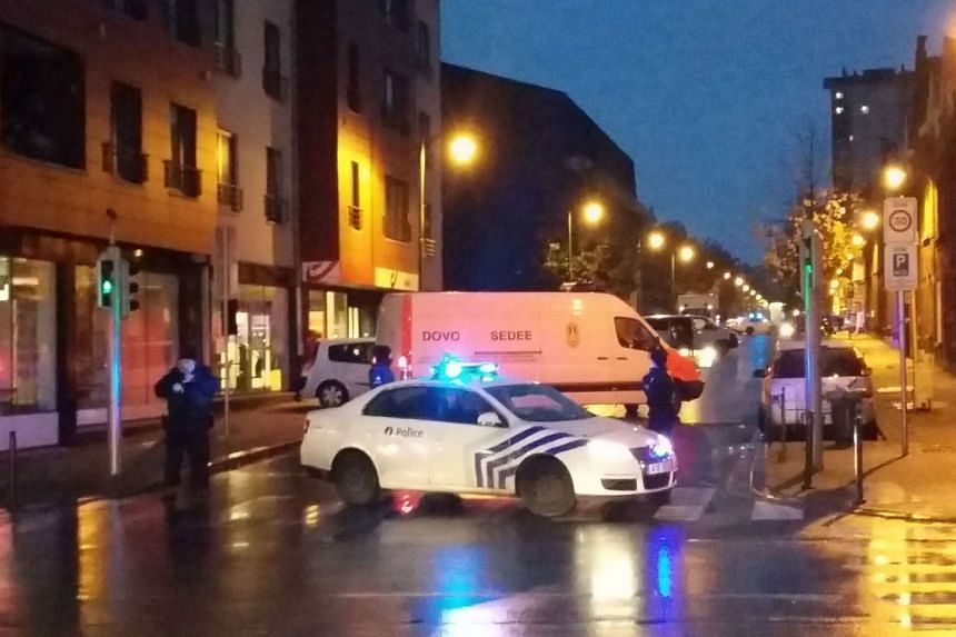 A cellphone photo shows a van of the Belgian bomb disposal unit as the police block a street in Molenbeek.
