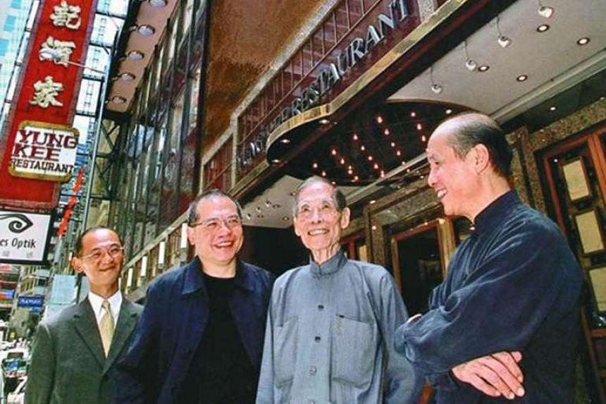 Founder of Yung Kee roast goose restaurant Kam Shui Fai (centre in grey), with sons (from left) Kwan Ki, Ronald and Kinsen, in happier times.