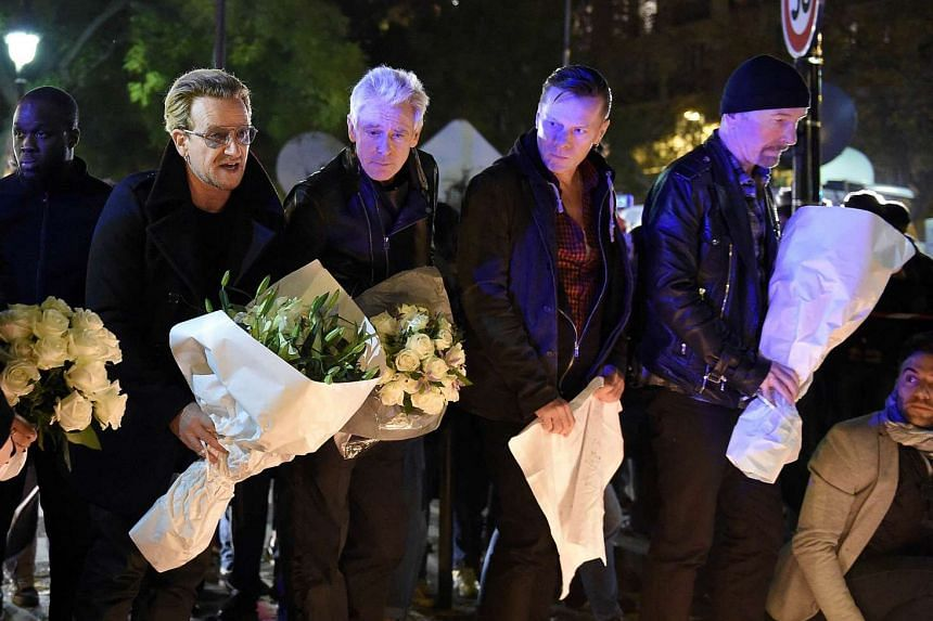 U2 pay homage to attack victims near the Bataclan concert hall.