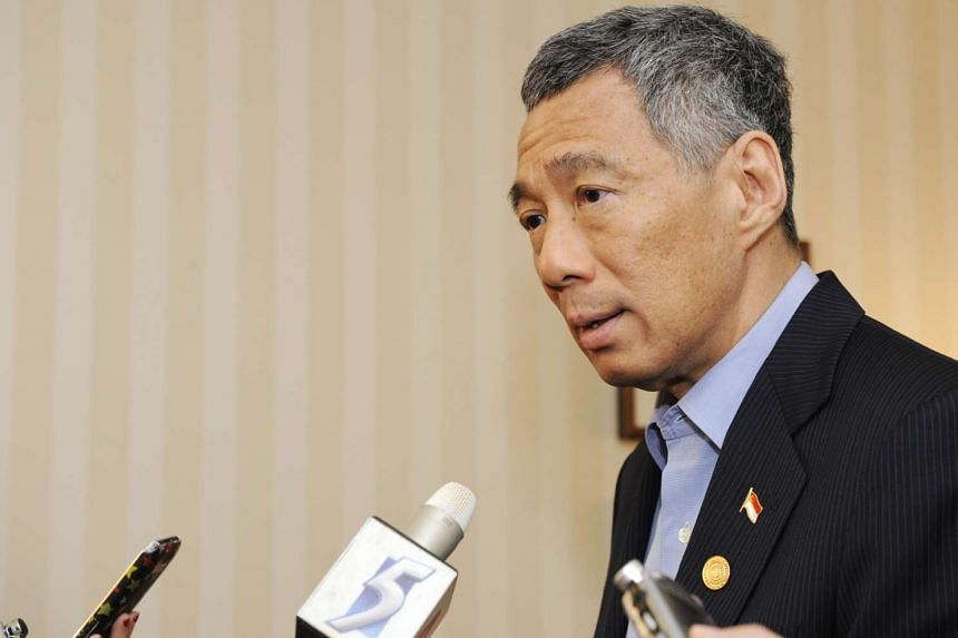 Prime Minister Lee Hsien Loong during a press conference at the end of the Commonwealth Heads of Government Meeting (CHOGM) 2011.