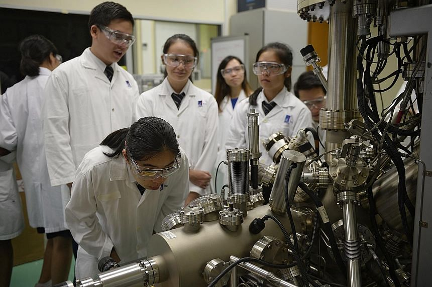 St Andrew's Junior College students observing X-ray Photoelectron Spectroscopy at the Central Lab during a visit to the Institute of Chemical and Engineering Sciences on Thursday.
