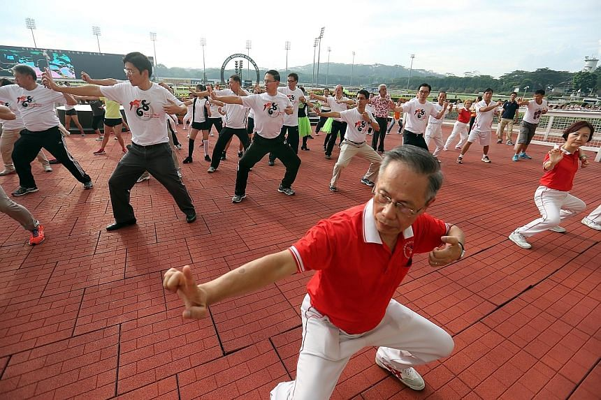 Close to 4,700 North West Health Qigong Club members and residents of the North West district gathered at the Singapore Turf Club yesterday for a record-breaking qigong workout, which contributed to the donation of some 25,000kg of rice to the needy.