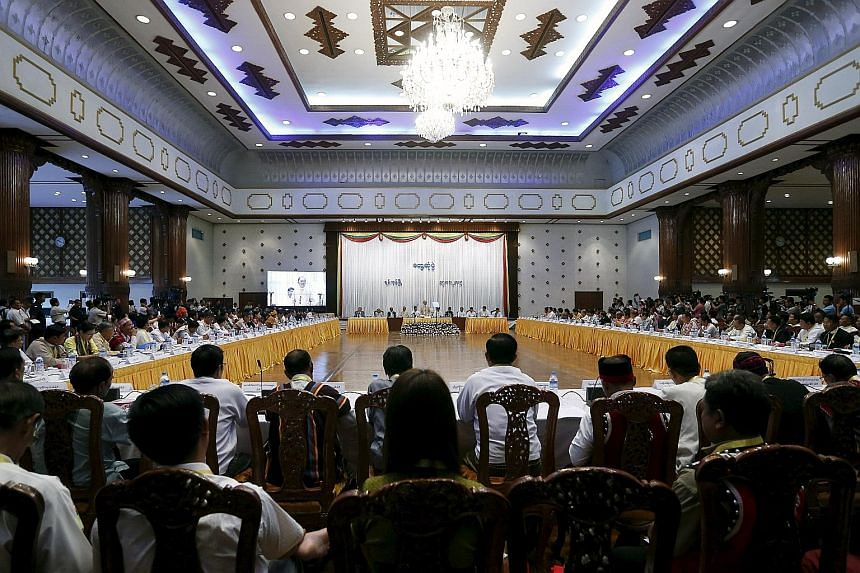 Myanmar President Thein Sein (above) speaking at a meeting of nearly 90 political parties in Yangon yesterday. The former junta general appeared sanguine about the resounding defeat of his army-backed Union Solidarity and Development Party, which wil
