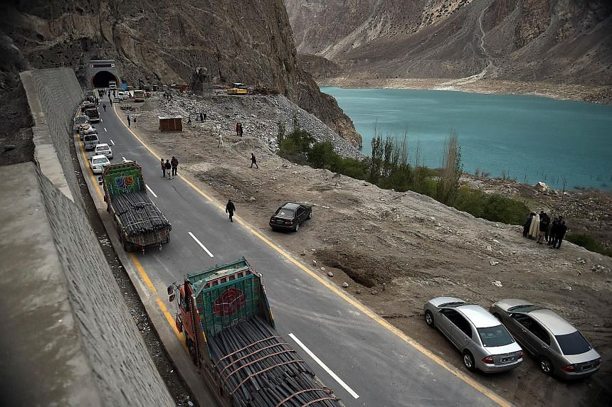 Commuters waiting to travel through the newly built tunnel in northern Pakistan, which took more than three years to build.