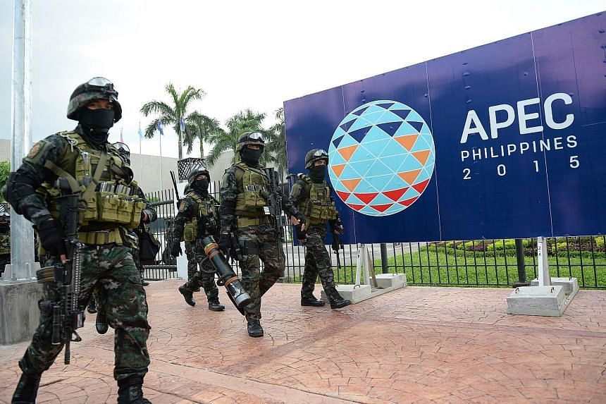 Members of the Philippines' Special Action Force at the Apec summit venue in Manila after a drill last Saturday. The capital is on lockdown, as more than 7,000 world leaders and delegates have begun gathering there for the annual series of meetings f