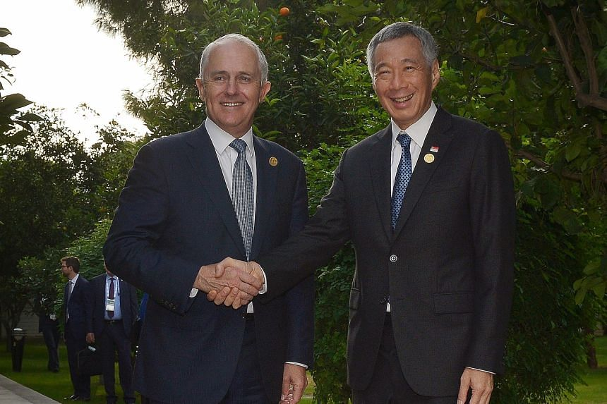 Prime Minister Lee Hsien Loong and Australian Prime Minister Malcolm Turnbull greeting each other before their breakfast meeting yesterday in Antalya, Turkey, where both leaders are attending the G-20 Leaders' Summit. It was their first meeting since