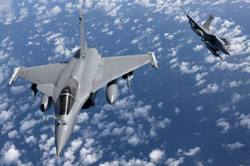 A 2011 file photo showing French Rafale fighter jets in flight. France conducted an air strike against the ISIS stronghold in Syria's Raqa on Nov 15, 2015.