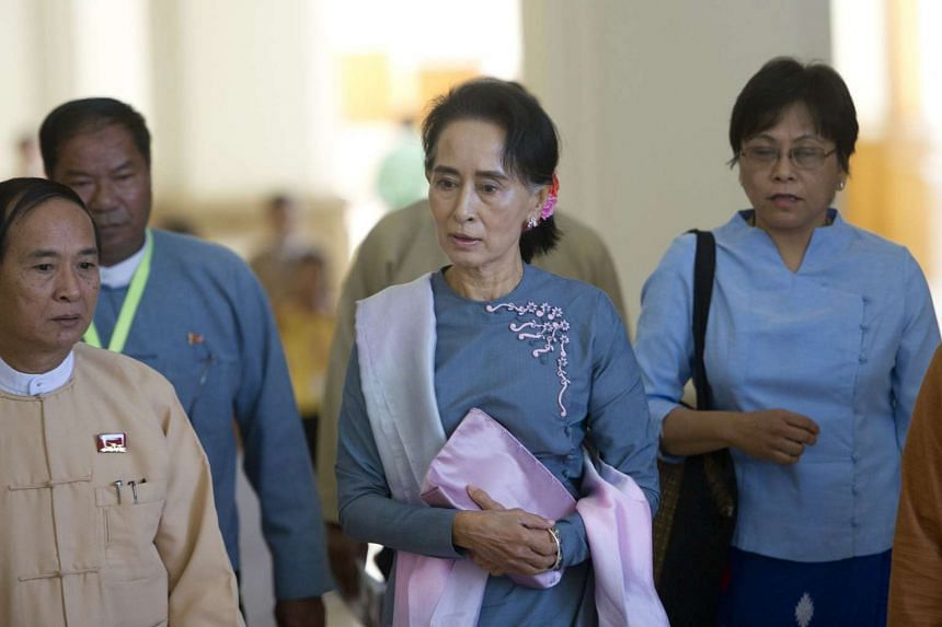 Chairperson of National League for Democracy Aung San Suu Kyi (center) arrives for Myanmar's first Parliament meeting on Nov 16, 2015 after the general election.