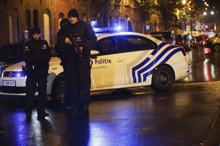 Police officers in the streets of Molenbeek, Brussels, Belgium, on Nov 14 2015.